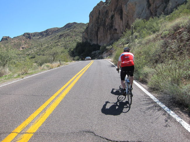 Jim riding next to the cliffs along Canyon Lake