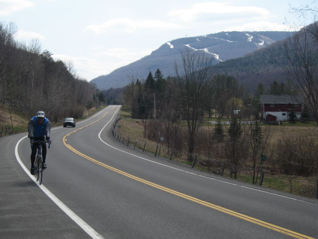 Chris descending on NY23A - Hunter Mtn in the background